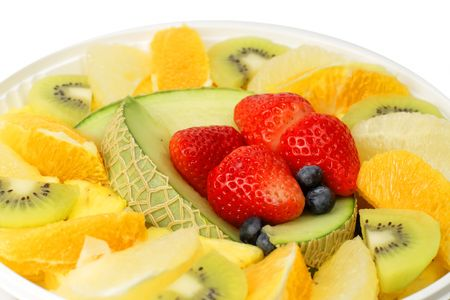 Extreme close-up image of a plate with assorted exotic fruits. photo