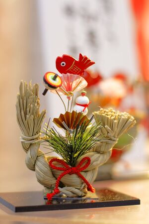 Traditional Japanese New Year decoration on a street shop stand. photo
