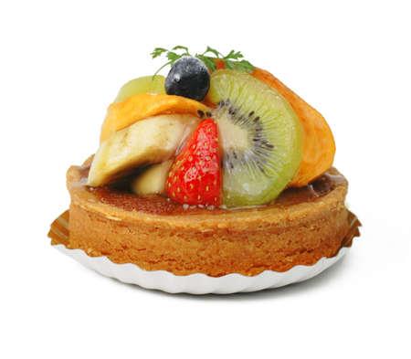Tasty fruits tart over white background photo