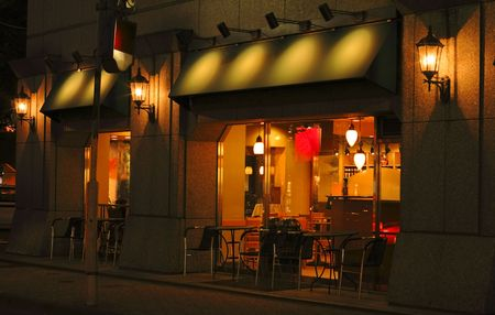 The coffee bar  from the street corner-night view. Stock Photo