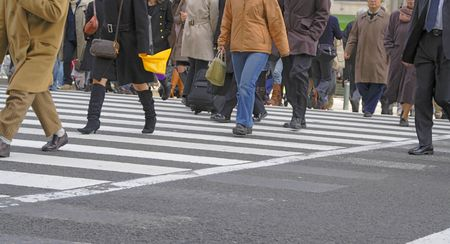 cross walk: People crowd crossing the street in a city-frontal view. Stock Photo