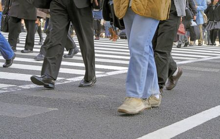Low angle image of a people crowd crossing the street Stock Photo - 759393