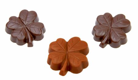 Three chocolate clover isolated over white background. photo