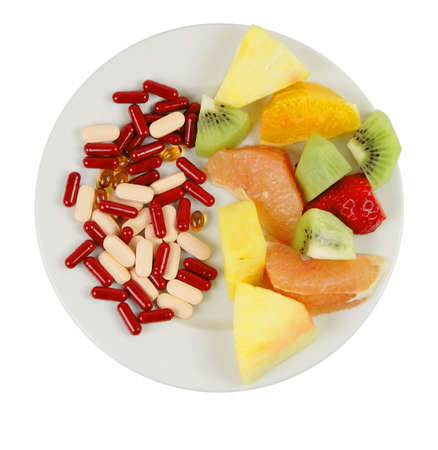 Vitamin choices on a plate:natural and artificial.......you must chose!!!...educational nutritional image. photo