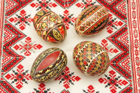Romanian painted Easter eggs on a traditional towel. photo