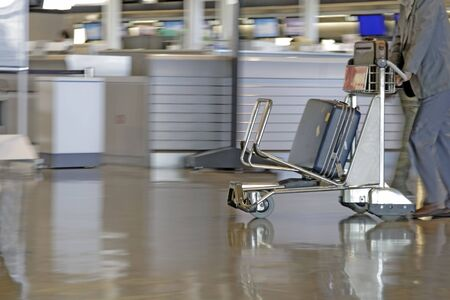 Motion image of a man pushing a cart in an airport. Stock Photo - 829026