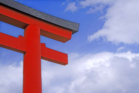 promover: Image of a traditional Japanese temple gate over a cloudy sky.Ideal image to promote any trip to traditional Japan.