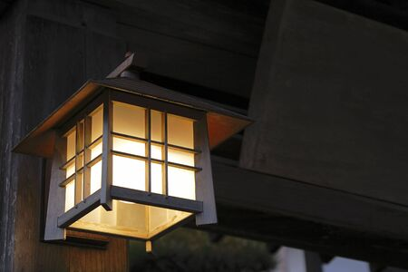 specific: Specific Japanese wooden lantern at the entrance in a wooden building.