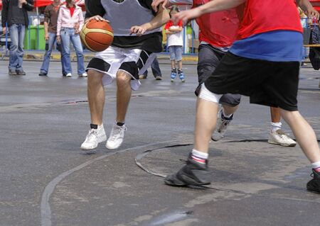 Action detail image of a streetball match. photo