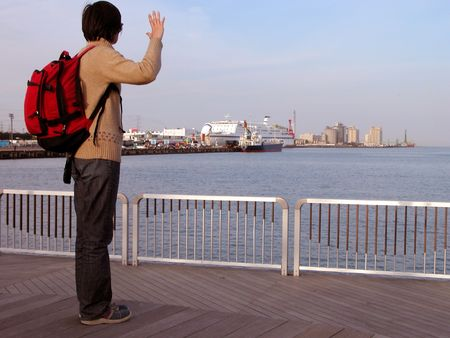 Girl saying good bye to her lover in a port...........          photo