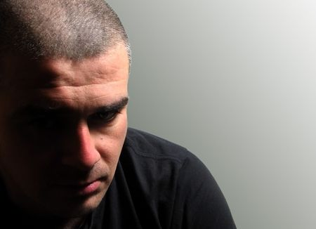 Portrait of a man with a depressed expression           photo