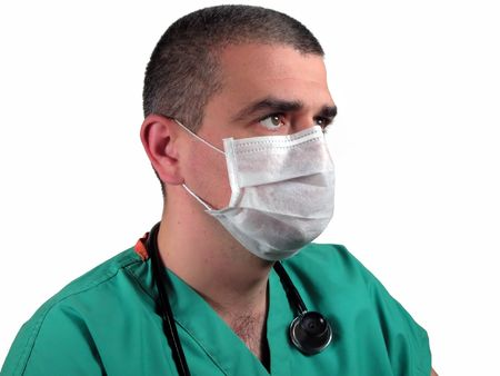Doctor with mask looking into a direction.           photo