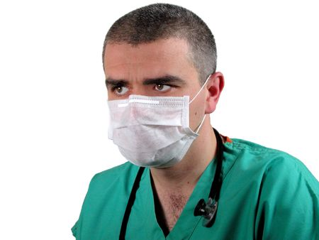 ICU doctor with mask looking with atention in a direction.....to a monitor for example.           photo