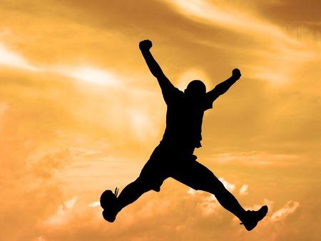 joyfull: Black silhouette of a jumping man against the sunset sky