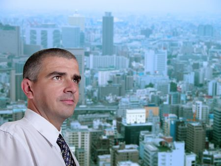 Portrait of a business manager in his office near the window in a metropolis.         photo