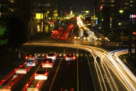 Traffic in a city crossroad during the night.           photo