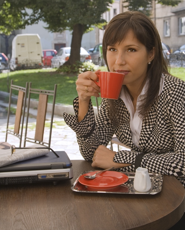 Businesswoman drinking coffee at the terrace. Stock Photo - 1535103