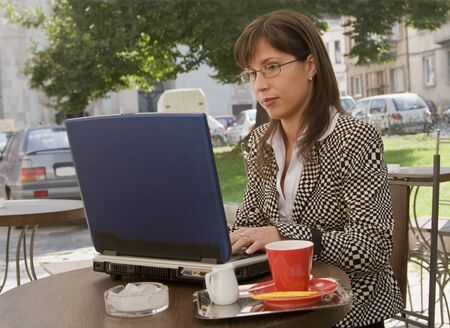 Image of a businesswoman working on laptop on a terrace. Stock Photo - 1622487