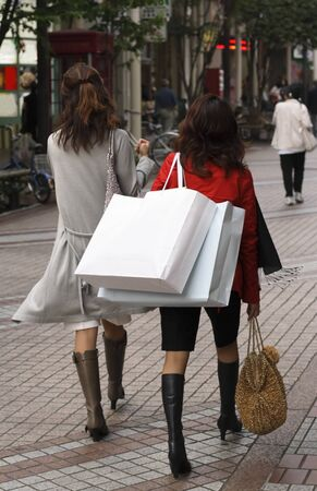 Two women shopping in a city street           photo