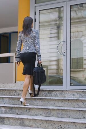 Bussinesswoman getting in a corporate building. Stock Photo - 1697231