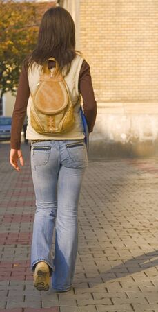 College girl with backpack walking near the university buidling. Stock Photo - 1710432