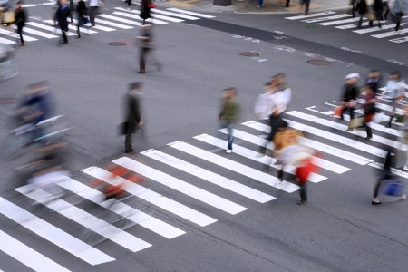 Aspect of a pedestrian cross with motion blurred aspect of the people.           photo