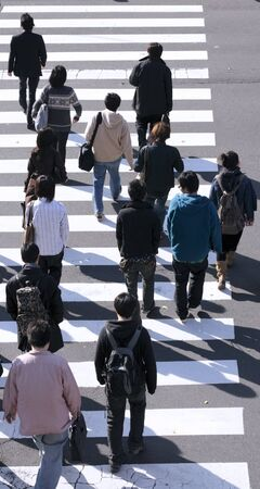 midday: Group of people crossing the street-upper view during the midday.