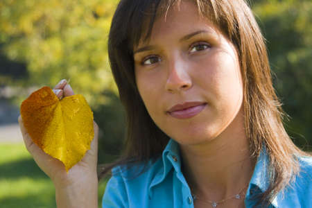 Portrait of a yooung woman with a wet leaf in hand. Stock Photo - 1796169