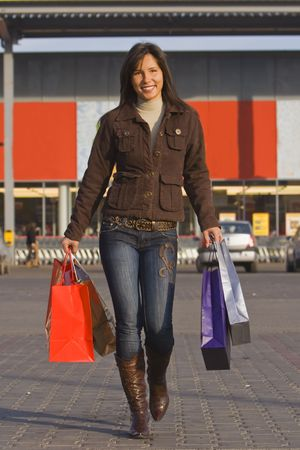 Image of a young lady with shopping bags in front of the supermarket. Stock Photo - 1930914