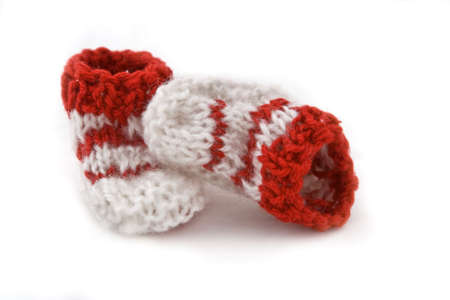 Funny knitted  footwear isolated over white background. photo