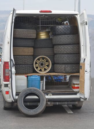 hubcaps: Image of a service truck carrying wheels for rally cars