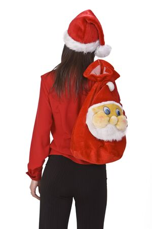 santaclause hat: Young brunette carrying a funny Santa sack.