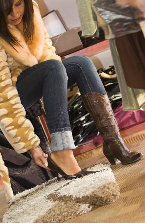try: Young woman trying on new shoes in a store. Stock Photo