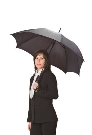 EASE: Beuatiful brunette businesswoman with umbrella.