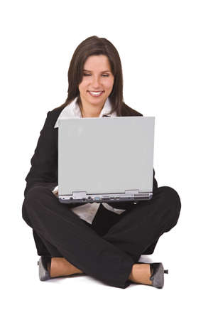 Businesswoman sitting with a laptop in her lap photo