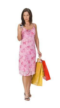 Woman with shopping bags checking her mobile phone. Stock Photo - 2384130