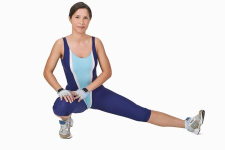 Young woman doing stretching movements during warming up Stock Photo - 2435475