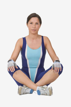 Woman in fitness equipment sitting with her legs crossed. Stock Photo - 2435478