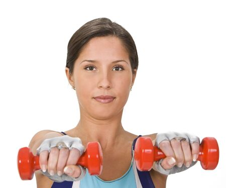 Portrait of a young woman doing barbells exercises. Stock Photo - 2441938