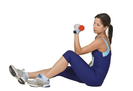 Young active woman doing a barbell exercise. Stock Photo - 2441947