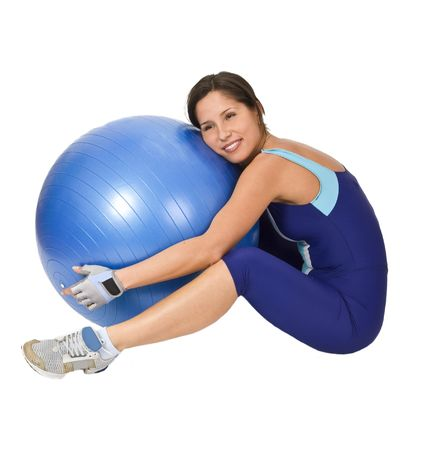 Tired young woman hugging the gym ball at the end of the programme. Stock Photo - 2441948