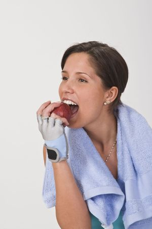 Beautiful young woman bitting a red apple. Stock Photo - 2639853