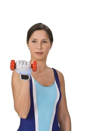 Portrait of a woman doing barbell exercises. Stock Photo - 2655220