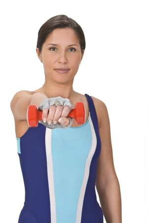 Portrait of a woman doing barbell exercises,selective focus on the barbell. Stock Photo - 2655219