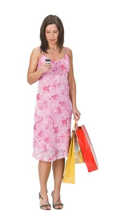 Woman with shopping bags checking her mobile phone. photo