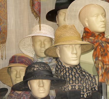 heats: Hats shop window aspect with different mannequins wearing heats. Stock Photo