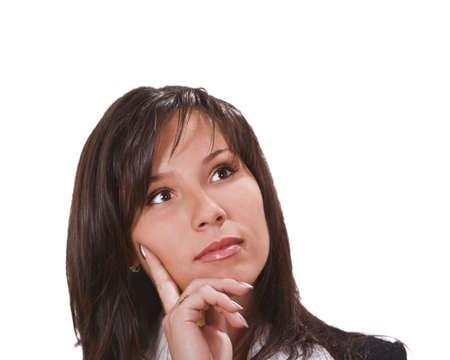 finger on lips: Portrait of a beautiful brunette thinking.