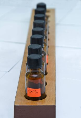 sulphuric acid: Image of a row of brown laboratory bottles.