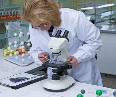 Female researcher working with a microscope in a laboratory. Stock Photo - 3073708