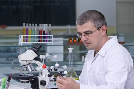 Researcher thinking about an experiment at his workplace. Stock Photo - 3169624